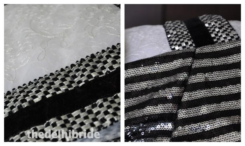 A self-work net white sari with heavy sequin border