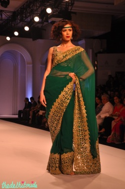 Doesn't the cutwork and whole outfit look a bit too Meena-Bazaar types?