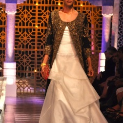 A pretty white wedding gown with a long contrasting embellished jacket? Floored!