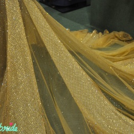 The subtle shimmer on the same gown