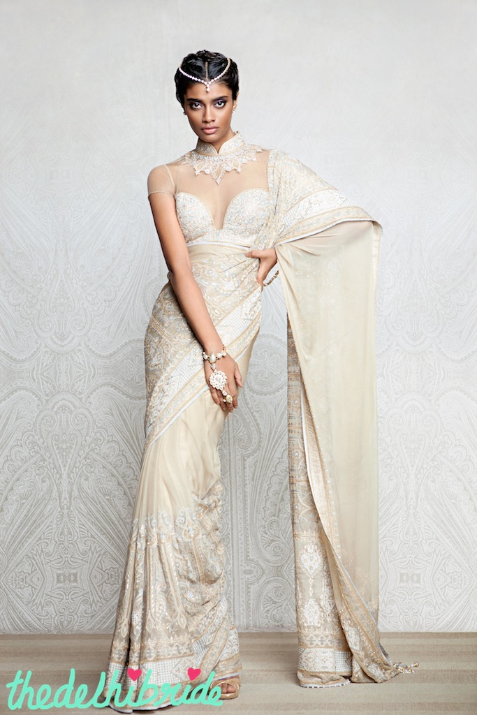 A gold shadow sari embellished with aari work on the borders and encrusted with Swarovski Elements. Sari paired with a sensuous, fully encrusted contoured blouse.