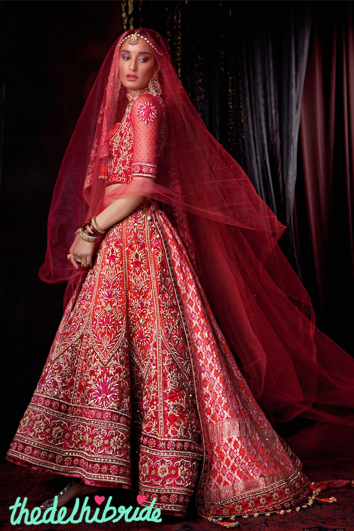 A zardozi embroidered graded bridal lehenga