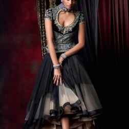 Asymmetrical froufrou tulle skirt in black and beige, worn with a sculpted blouse, embellished with Swarovski Elements