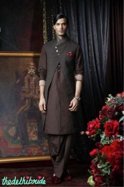 A chocolate, front open sleeveless sherwani, worn with a linen kurta and salwar. Sherwani embellished with kantha embroidery, satin pleated collar and mother of pearl jewel buttons.