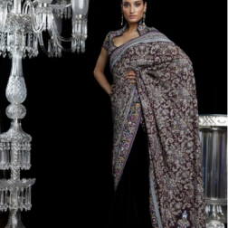 A graceful Jamewar inspired sari drawing its palette from the colours of a peacock and embellished with aari work. Worn with a stylised blouse
