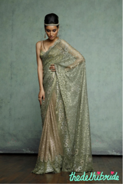 A sari painted in gorgeous shades of olive and gold, encrusted fully with Swarovski Elements. Paired with a shaded, contoured corset, embroidered with resham and paved on top