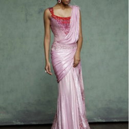 A fully sheathed concept sari in different shades of pink, draped and sculpted into a sensuous silhouette. Combined with a Swarovski Elements bodysuit