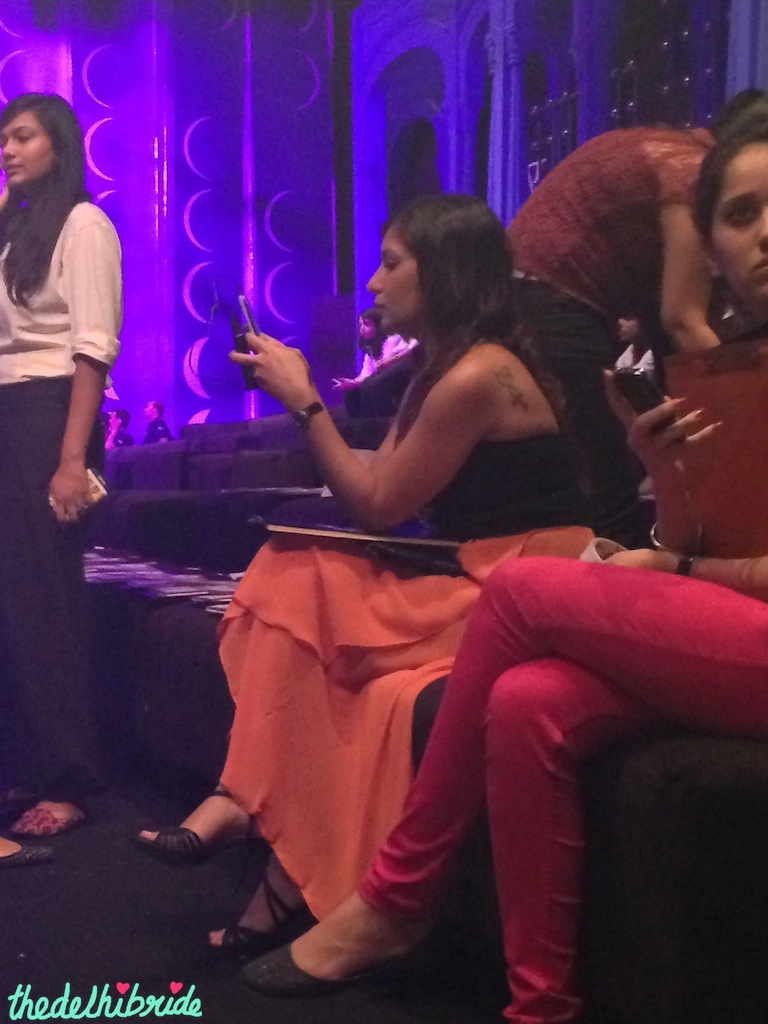 MissMalini typing away furiously on her phone during a show on Day 2
