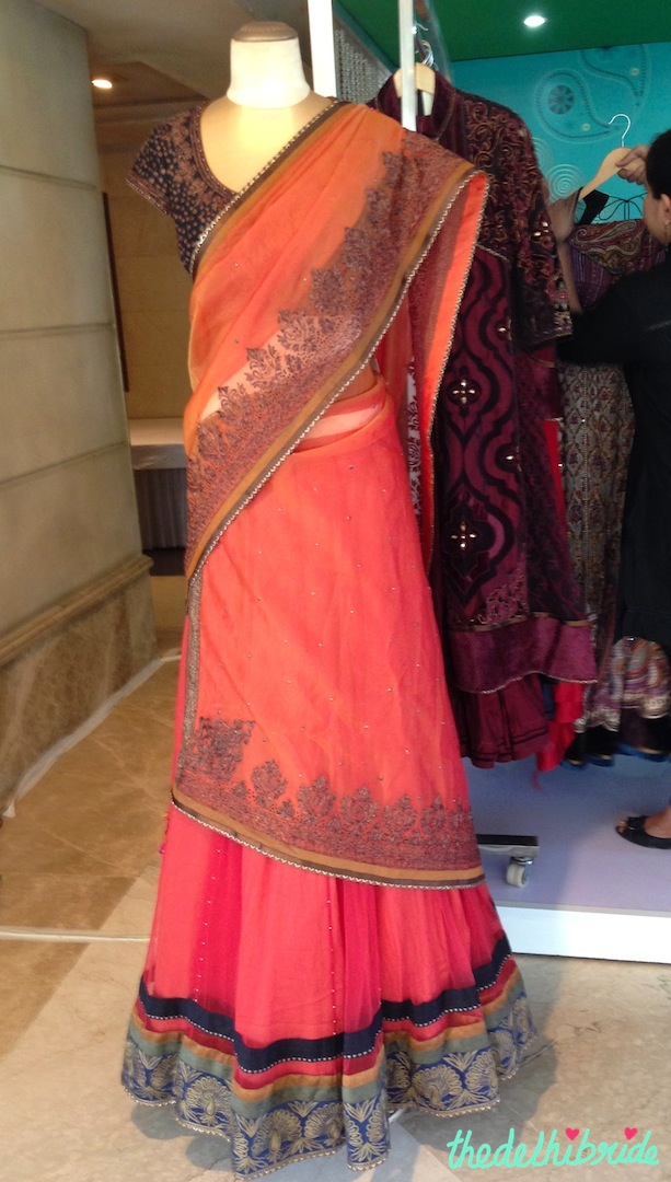 Isn't this orange lehenga soo pretty? INR 70,000 (you can also buy it online here)