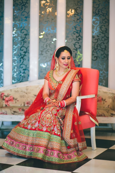 wedding lehenga from Chandni Chowk full length front sitting Sumedha wedding wardrobe