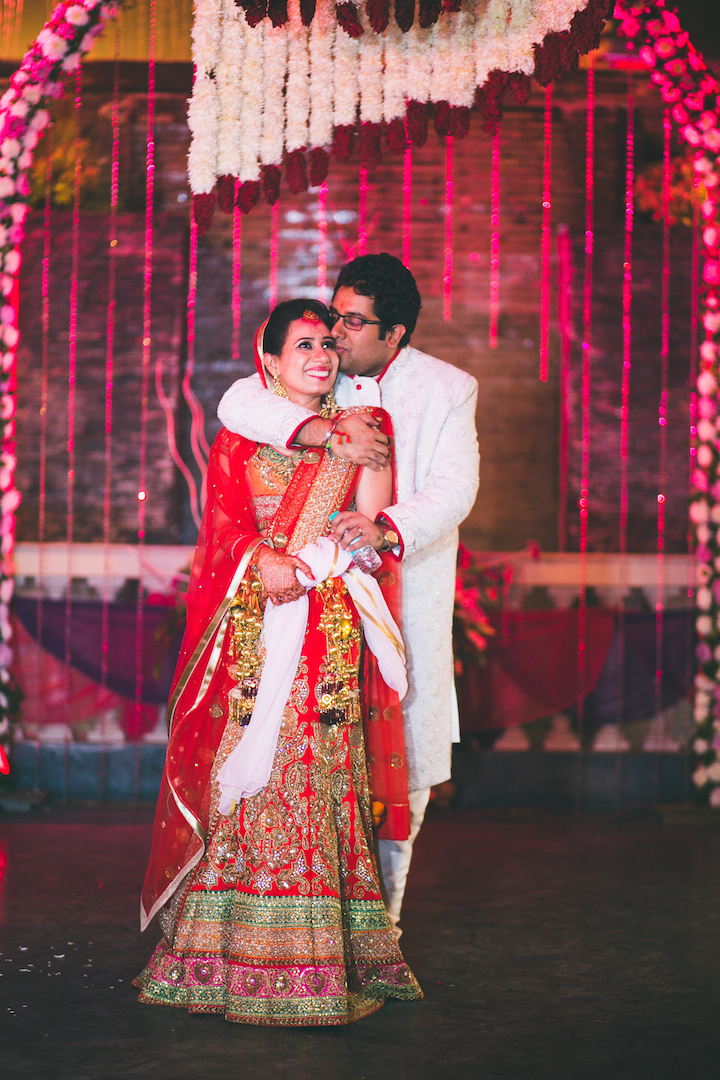 With her husband, Ankur
