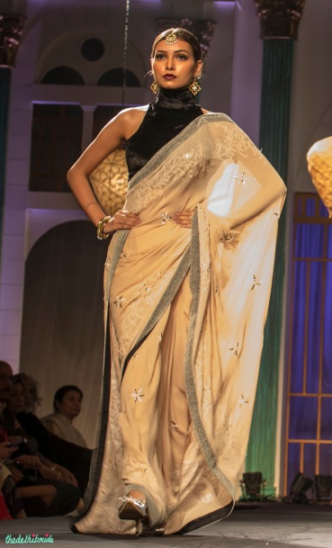 Beige sari with black halter velvet blouse