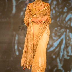 ivory and gold sari with maroon piping Tarun Tahiliani India Bridal Fashion Week 2014
