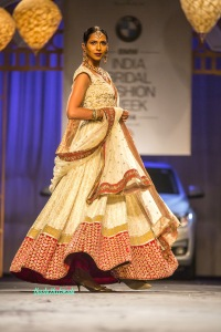 The flare of the ivory and red lehenga