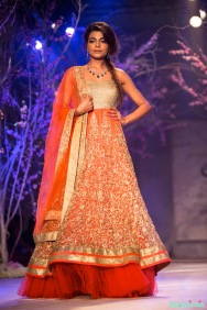 Orange gold anarkali with green emerald jewellery