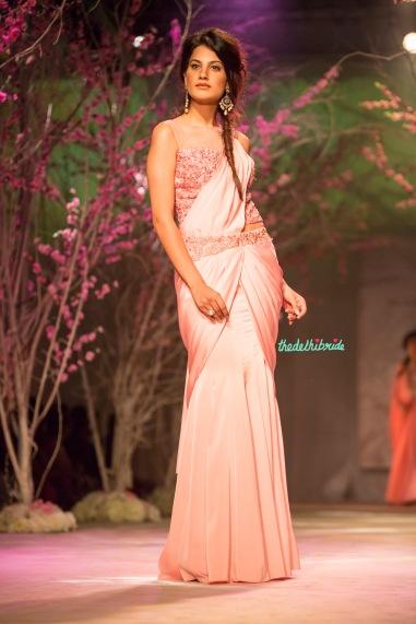 Pale pink pre-pleated sari