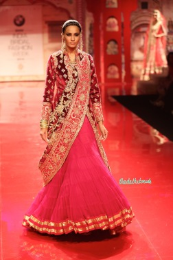 Red velvet jacket with pink net lehenga