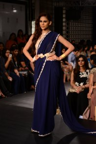 Ridhi Mehra deep blue sari with leaves design belt and ivory lace embroidered blouse