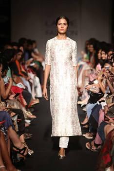 Sanjay Garg white sherwani style suit for women