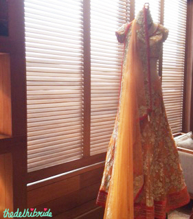 The same orange lehenga displayed in-store