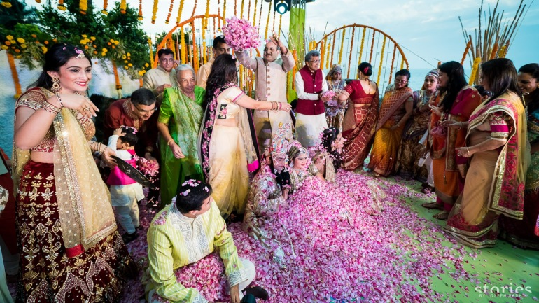 Brij Holi at wedding function shower of petals on bride and groom