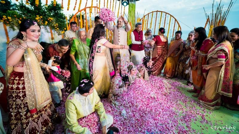 Brij Holi at wedding function shower of petals on bride and groom