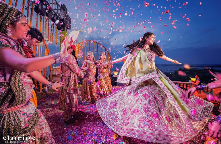 Brij Holi wedding pictures Joseph Radhik stunning backdrop Mumbai sea