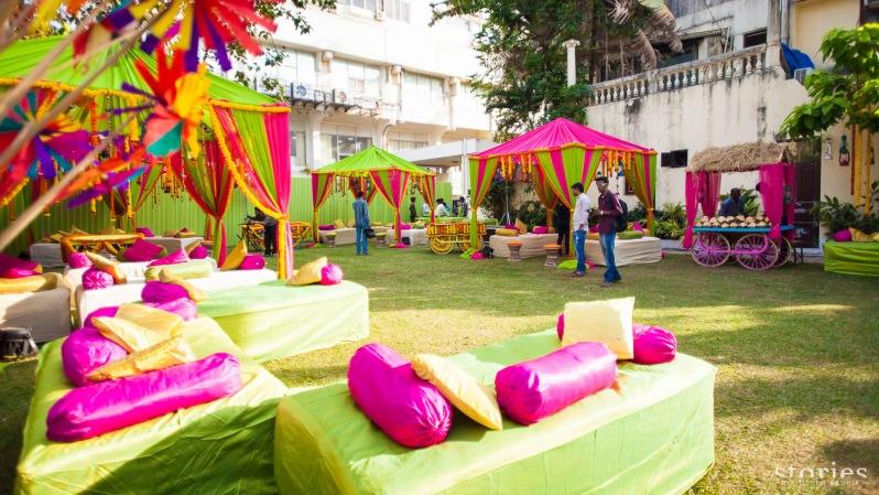 Colourful pink and green mehendi decor for day wedding Shonan & Adesh