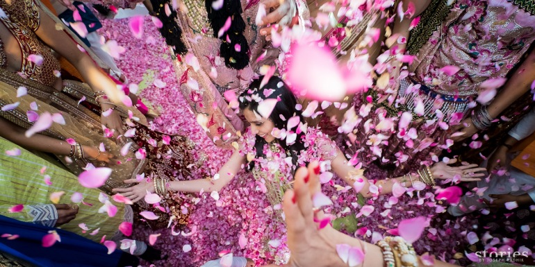 Shonan & Adesh Brij Holi shower of petals at wedding bride shot
