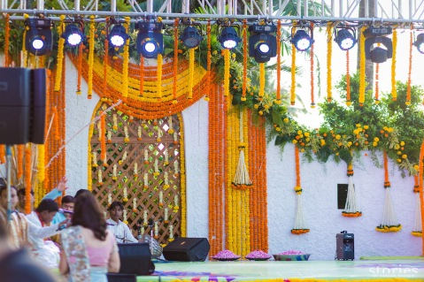 Stage backdrop for Brij Holi Shonan & Adesh | thedelhibride Indian weddings blog