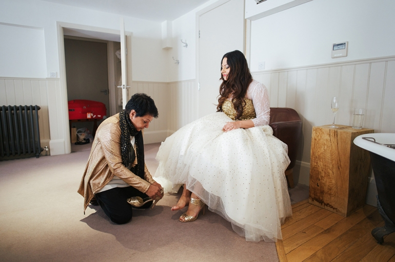 Getting Ready Bride putting on her shoes golden heels for white wedding gown | Anushka Hajela Wedding Wardrobe