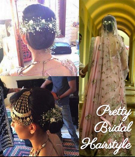 Pretty bridal bun for modern bride with flower arrangements in hair | Mira Rajput Shahid Kapoor wedding
