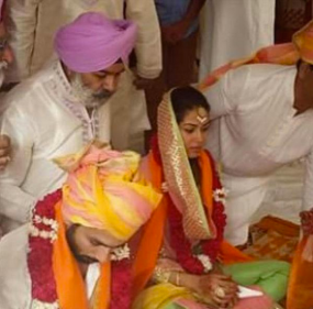 Shahid & Mira sitting for their wedding ceremony