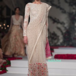 Off white Net Saree with Sequins and a Floral Embroidered wide border and Ivory Embroidered boat neck blouse with sheer long sleeves - Varun Bahl - Amazon India Couture Week 2015