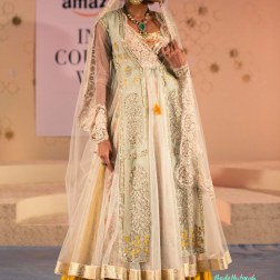 Layered jacket lehenga with a scalloped edge dupatta