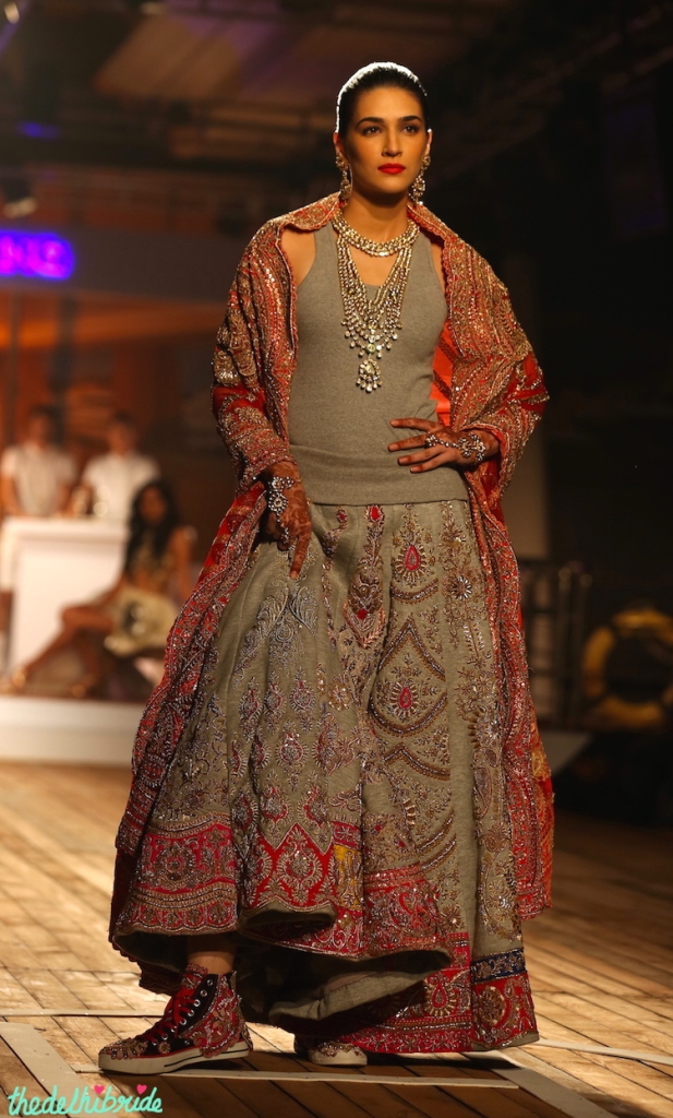 Embroidered sneakers with heavily embroidered zardosi work on jersey lehenga for new age bride at Kriti Sanon Monisha Jaising Amazon India Couture Week 2015 pic2