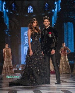 Falguni and Shane Peacock - Athiya Shetty in Black Sequin Gown and Sooraj Pancholi in Black Velvet Bandhgala - BMW India Bridal Fashion Week 2015