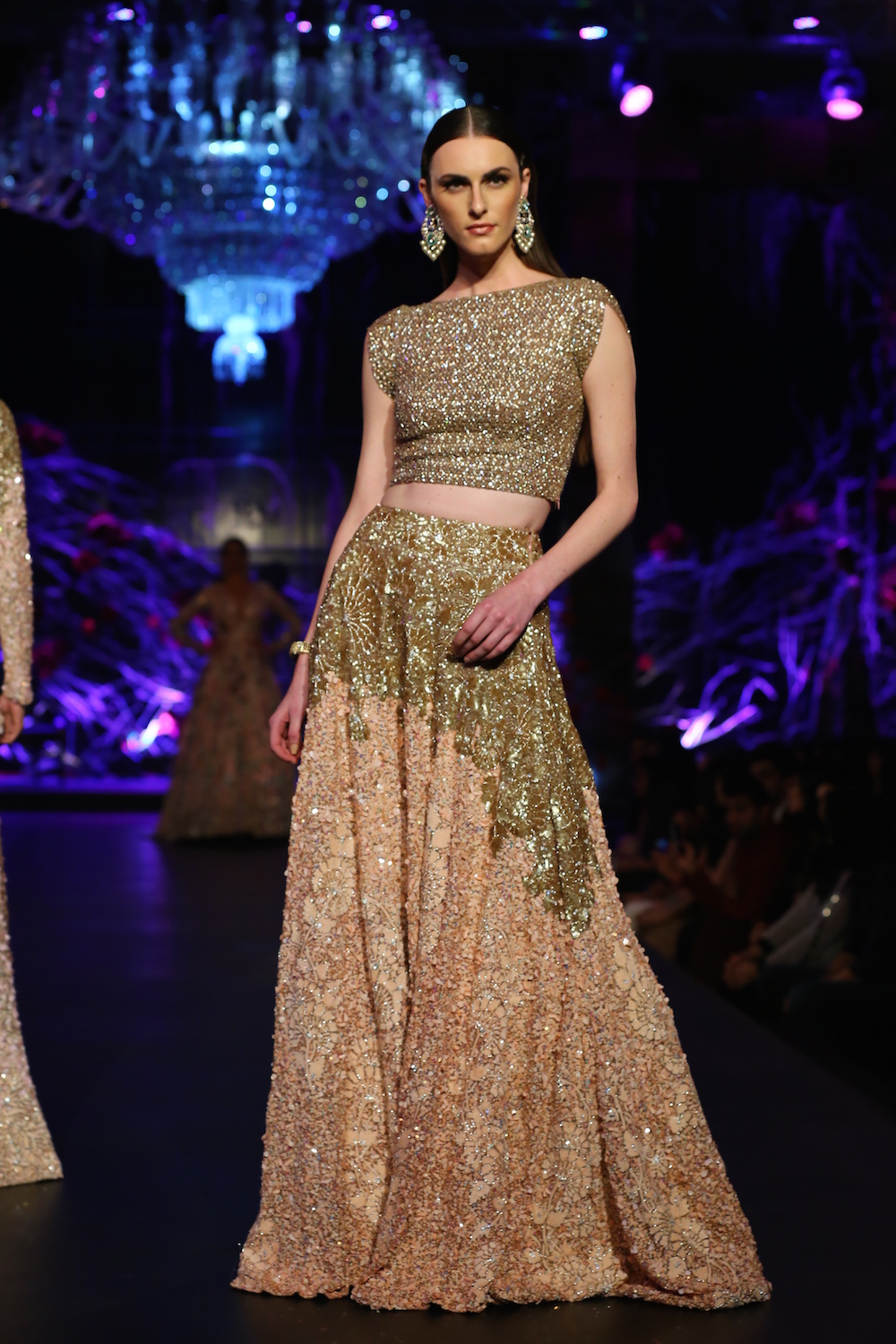 facb3900dd ... Amazon India Couture Week 2015. Gold Crop Top with Heavy Work & Beige  Lehenga with Gold Floral Work - Manish Malhotra
