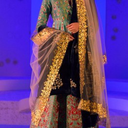 Floral embroidered blue anarkali with dual dupatta, one of which is a foil print light dupatta and the other is a midnight blue velvet dupatta