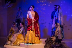Heavily embroidered yellow lehenga set with contrast velvet dupatta