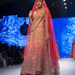 Heavy embrodiered shaded wedding lehenga in orange and red - Tarun Tahiliani - BMW India Bridal Fashion Week 2015
