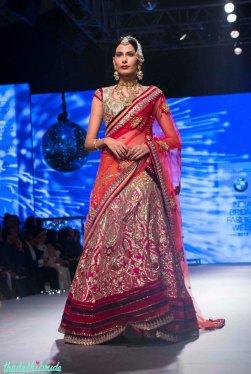 Heavy wedding lehenga in shades of pink and red - Tarun Tahiliani - BMW India Bridal Fashion Week 2015