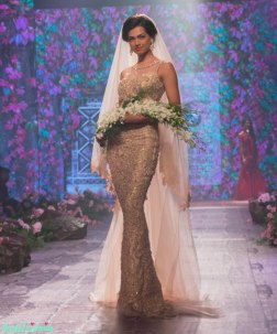 Jyotsna Tiwari - Ivory and gold fitted gown for a Christian bride - BMW India Bridal Fashion Week 2015