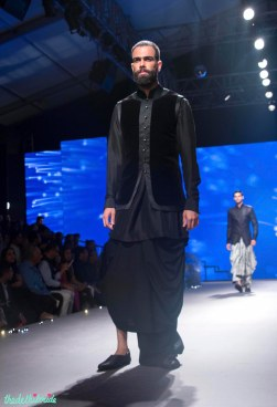 Men's Wear - Black Dhoti with Velvet Bandhgala Half Jacket over a black kurta - Tarun Tahiliani - BMW India Bridal Fashion Week 2015
