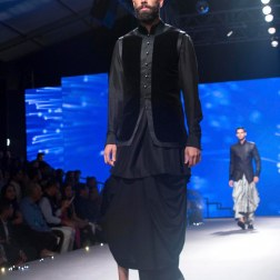 Men's Wear - Black Dhoti with Velvet Bandhgala Half Jacket over a black kurta - Tarun Tahiliani - BMW India Bridal Fashion Week 2015