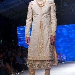 Men's Wear - Cream Chikankari Sherwani Jacket with Embroidered Ari Work, Gold Kurta & Churidaar - Tarun Tahiliani - BMW India Bridal Fashion Week 2015