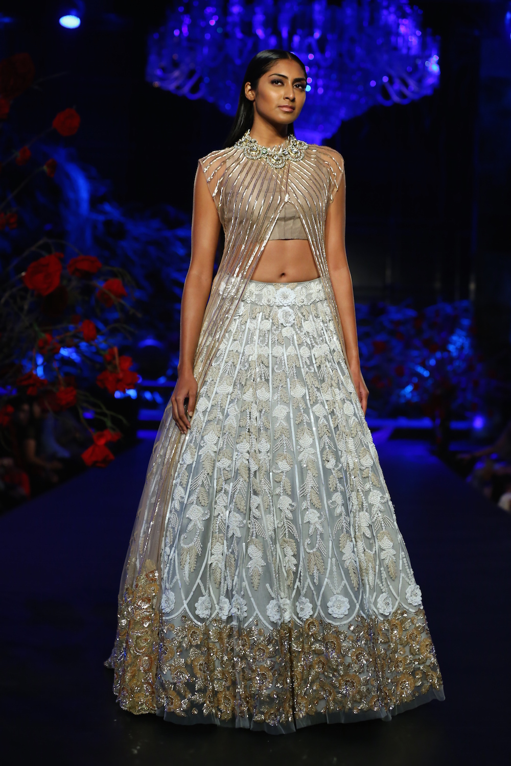 aaf1e4b69f ... Amazon India Couture Week 2015. Pale Blue Embroidered Lehenga Skirt  with Heavy Floral Border, Onion Pink Crop top & Onion