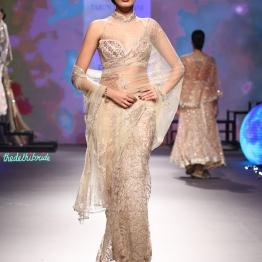 Sheer embroidered net sari with swarovski embellishments and embroidery | Halter neck blouse - Tarun Tahiliani - BMW India Bridal Fashion Week 2015