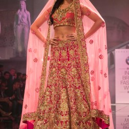 Suneet Varma - Pernia Qureshi in a Heavily Embroidered Fuschia Pink Bridal Lehenga with Gold Work - BMW India Bridal Fashion Week 2015