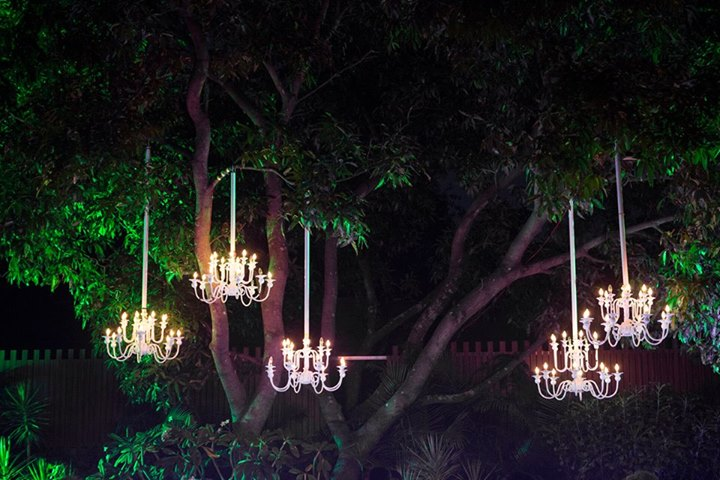 3 Productions - Outdoor wedding decor idea - Chandelier hanging on trees - Best of weddings this week